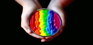 Hands holding rainbow colored paint piqsels.com-id-zkpsl