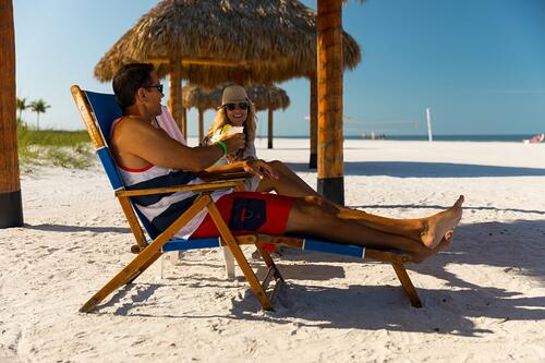 Pink Shell Resort - Couples on the Beach in Lounge Chairs