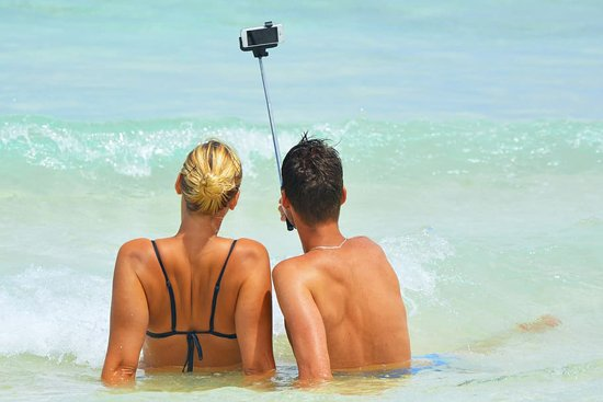 Couple on the Beach with a Camera
