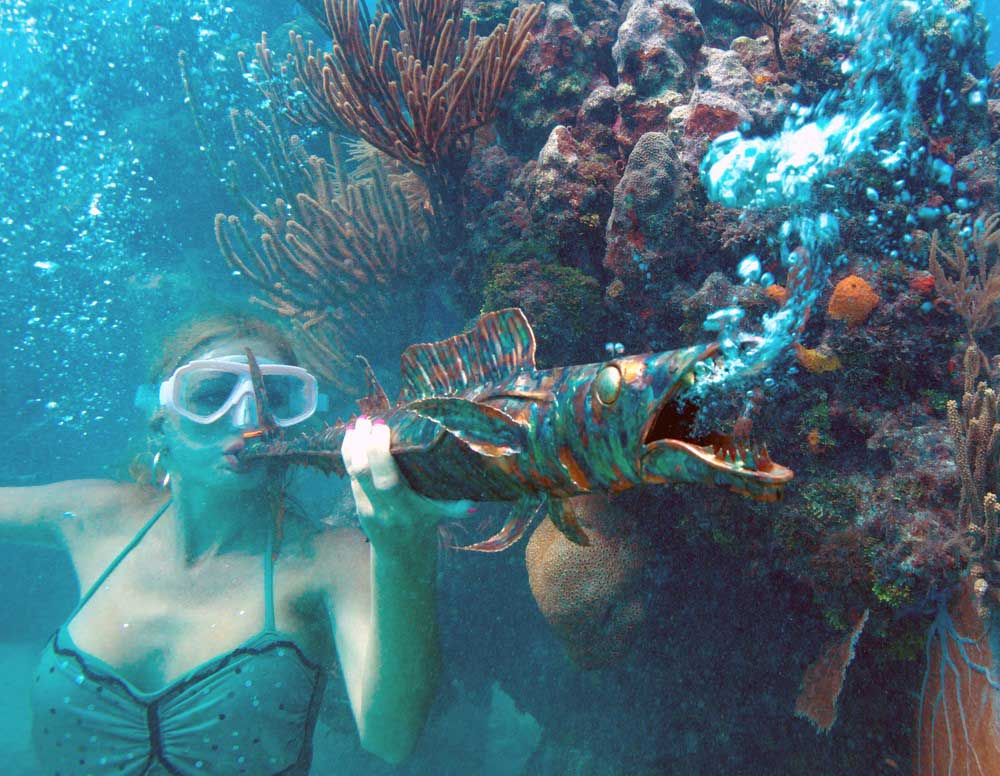 Woman playing a horn underwater
