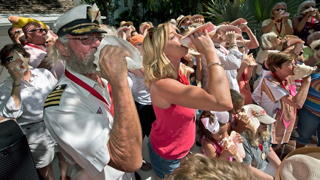 Blowing conch shells at the annual conch shell blowing contest